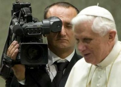 A CTV (Central Television Vatican) cameraman stands near Pope Benedict XVI during a weekly general audience in the Vatican in this August 27, 2008 file photo. Pope Benedict on Friday became one of the oldest people to have his own YouTube channel and cautioned young people to use new media wisely and avoid on-line obsession that can isolate them from real-life contact. The Vatican channel, www.youtube.com/vaticanit, will broadcast short video news clips on the 81-year-old pope's activities and Vatican and Church events, with audio and text initially in English, Spanish, German and Italian.