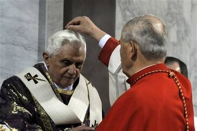 H.H. Pope Benedict XVI receives ashes on his head during an Ash Wednesday ceremony inside the fifth-century Basilica of St. Sabina to mark the start of the solemn Lenten season, in Rome, Wednesday, Feb. 6, 2008.