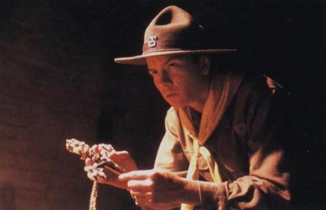 A young Indiana Jones as a Boy Scout holds the Cross of Coronado